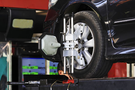 How does a Wheel Alignment Service Save Money?